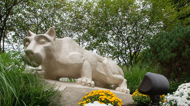 Nittany Lion Shrine with flowers and trees