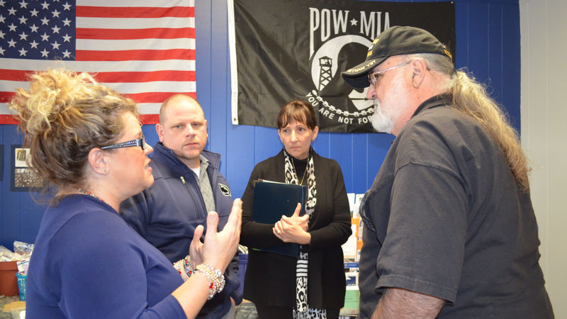 Guests talking during the campus' Veterans Center celebration on October 25.