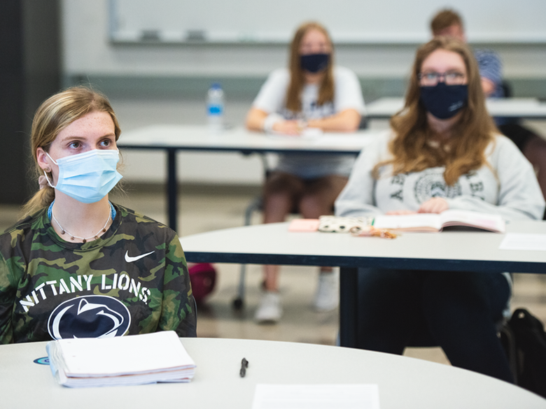Four students wearing masks in classroom