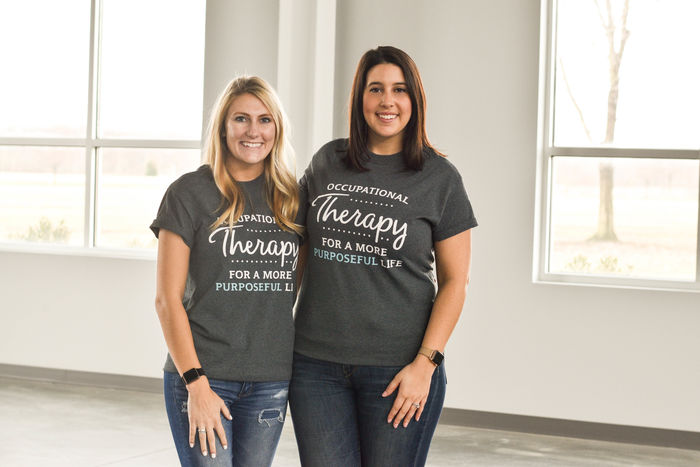 Holly Masters and Ali Izzo-Linton wearing t-shirts that read occupational therapy for a more purposeful life.