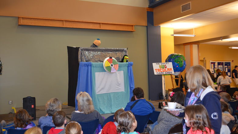 Children gather to watch much aniticpated puppet show during Earth Fest 2015