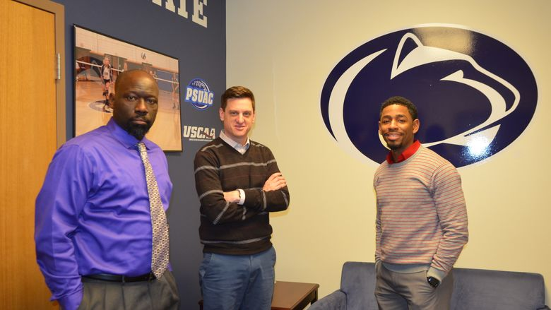 Three men standing in a Shenango campus office following a meeting about athletics.