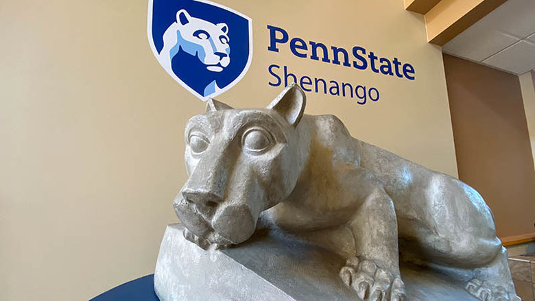 Lion Shrine statue under Penn State Shenango mark