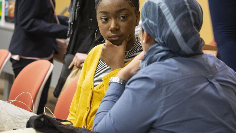 Faculty mentor, Ola Rashwan, speaks with high school student Zimirah Wilson at an EnvironMentors meeting in Harrisburg, Pennsylvania.