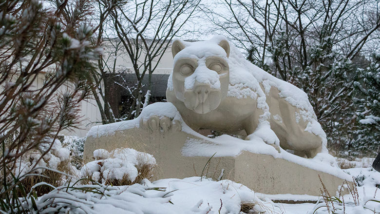The Lion Shrine, covered in several inches of snow, on a gloomy winter day